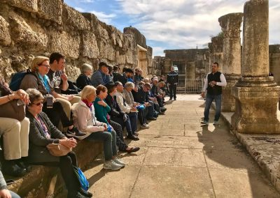 Hector Molina teaching at Capernaum White Synagogue with Select International Tours and Cruises